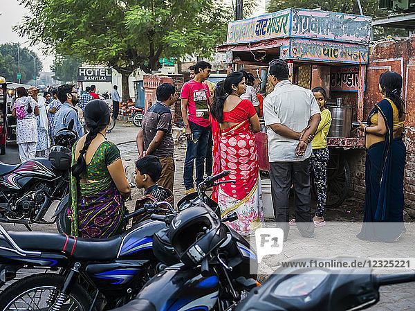 People lined up outside a vendor's stall to make a purchase; Jaipur  Rajasthan  India