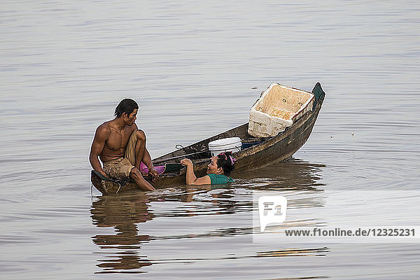 Couple fishing from a boat on the Tonle Sap; Siem Reap  Cambodia