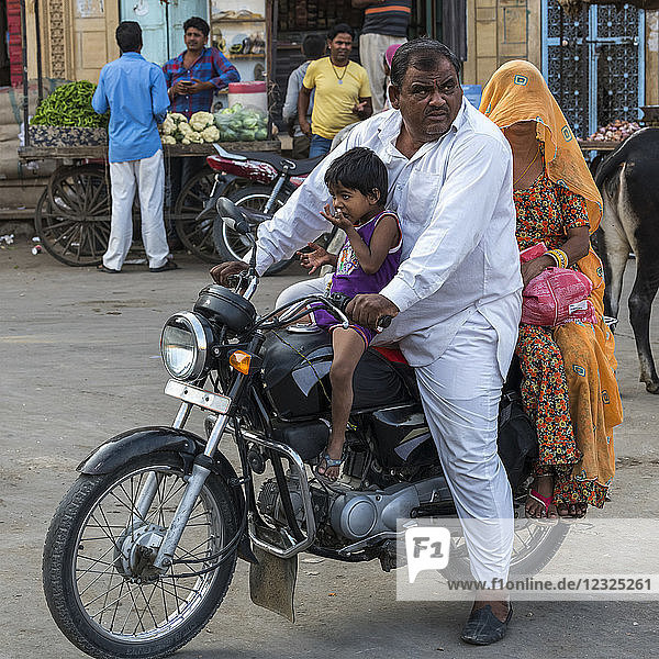 Family riding a motorcycle; Jaisalmer  Rajasthan  India