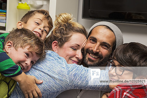 A family of five in a close embrace; Langley  British Columbia  Canada