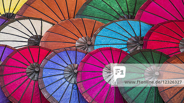 Bright coloured paper umbrellas for sale at the night market; Luang Prabang  Luang Prabang  Laos