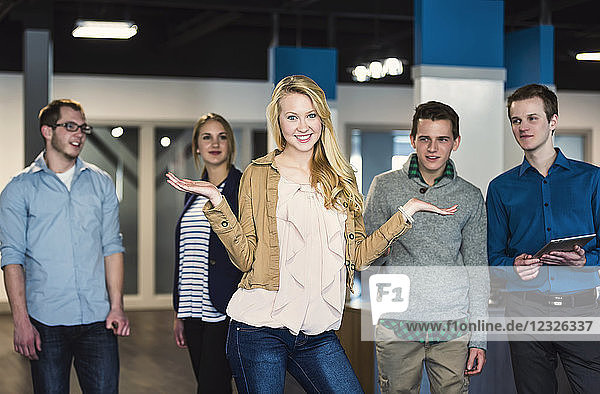Portrait of a group of young millennial professionals standing together in the workplace; Sherwood Park Alberta  Canada