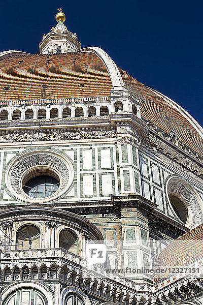 Close-up of Brunelleschi's Dome of Florence Cathedral decorative details of facade and blue sky; Florence  Tuscany  Italy