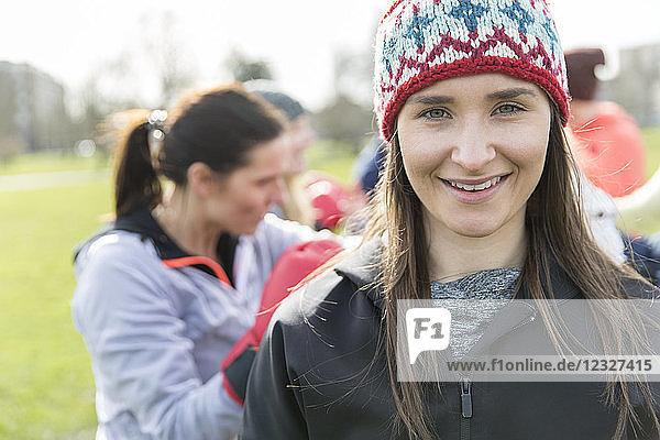 Portrait smiling  confident woman exercising in park