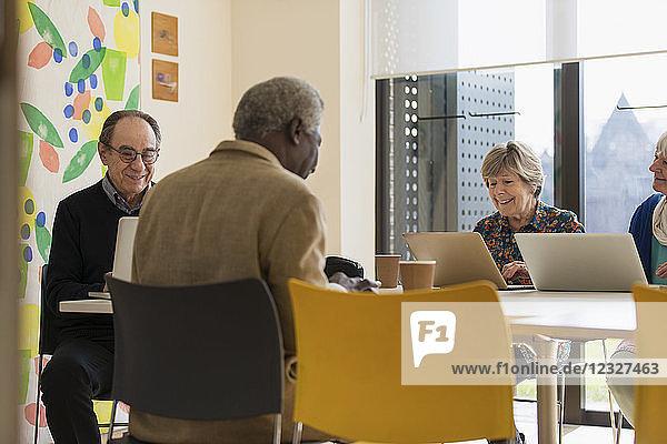 Senior business people working in meeting