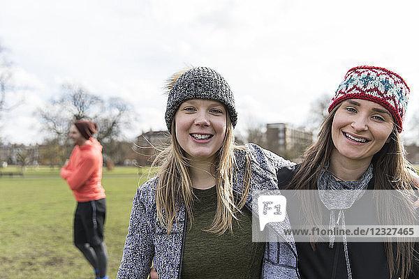 Portrait smiling  confident women in park