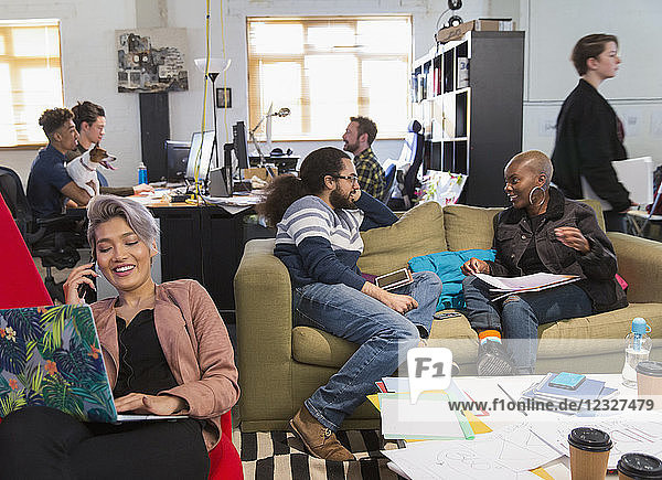 Creative business people meeting and working in casual  open plan office