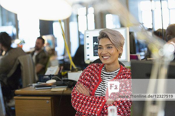 Smiling  confident creative businesswoman working in office Smiling, confident creative businesswoman working in office