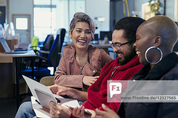 Laughing creative business people working in office