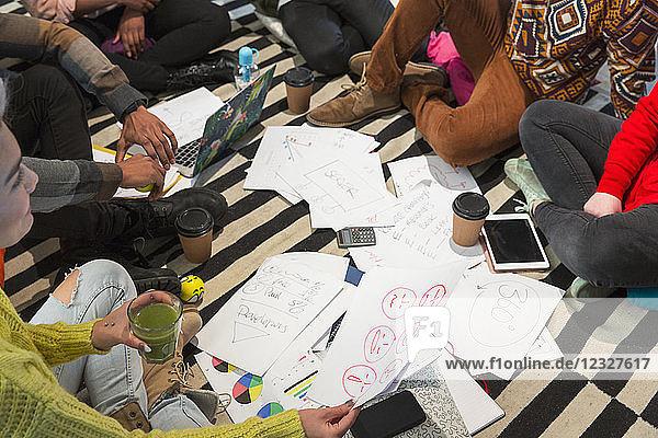 Creative business people meeting  brainstorming in circle on floor