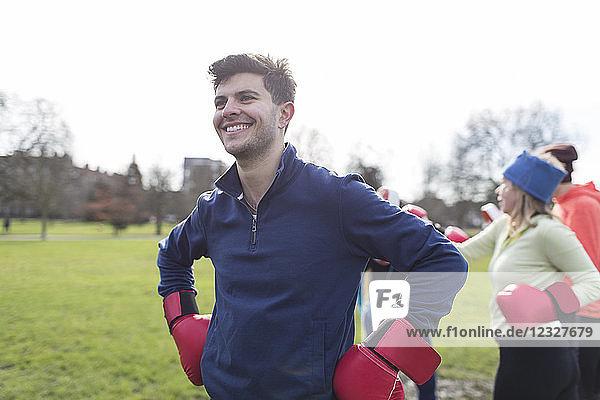 Portrait smiling  confident man boxing in park