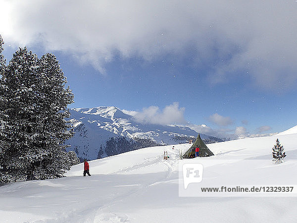 Austria  Tirol  Sellrain valley  a khaki tent in the shape of a teepee is set in the middle of a snow field in front of the Stubai alps