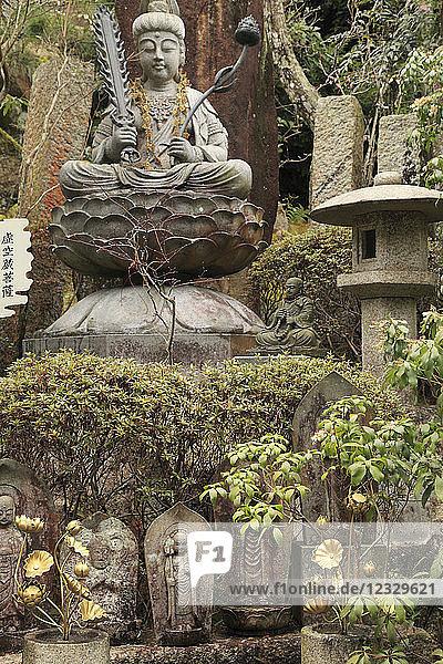 Japan  Miyajima  Daisho-in Temple  garden  Buddha statue