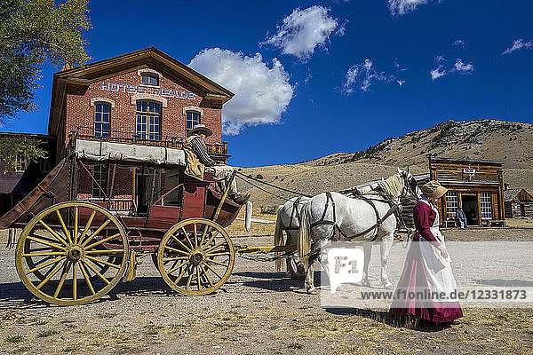 USA  Montana  Bannack  ghost town  stage coach in front of Hotel Meade in main street during Living History