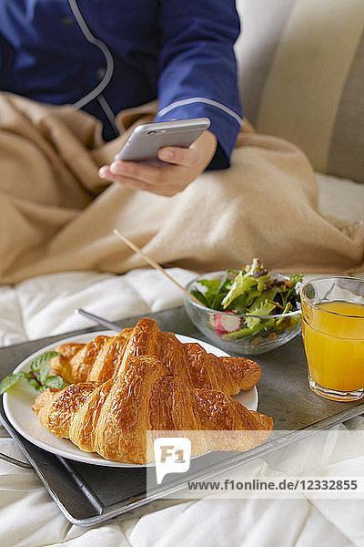 Japanese woman having breakfast in bed
