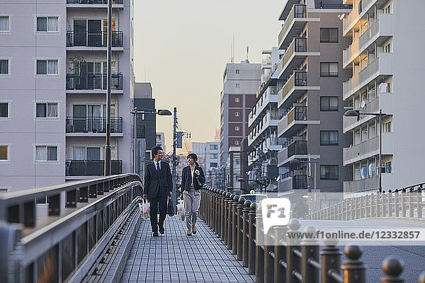 Japanese couple walking home from work