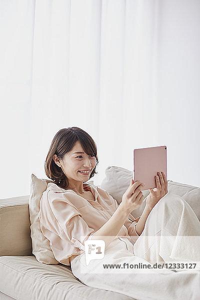 Young Japanese woman on sofa