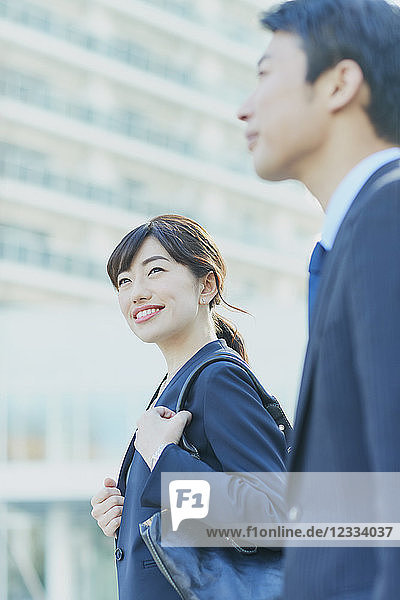 Japanese couple walking to work