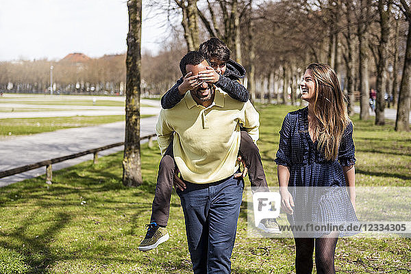 Happy family walking in a park