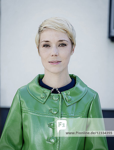Portrait of woman wearing green vintage leather jacket