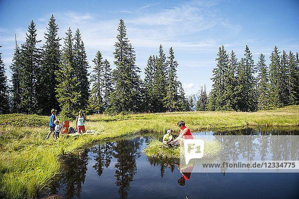 Austria  Salzburg State  Untertauern  family resting on a lake