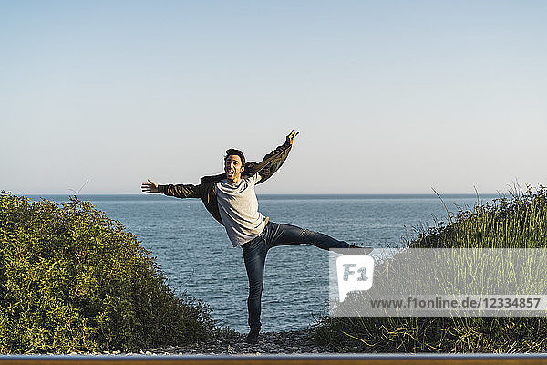 Spain  young man jumping in the air at the beach
