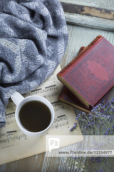 Cup of black coffee  book and music sheet