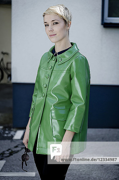 Portrait of woman wearing green vintage leather jacket