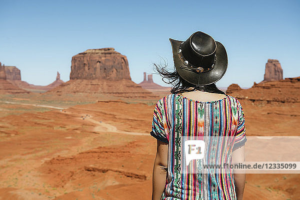 USA,  Utah,  Woman with cowboy hat enjoying the views in Monument Valley