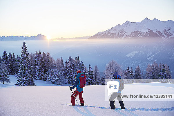 Austria  Tyrol  snowshoe hikers at sunrise