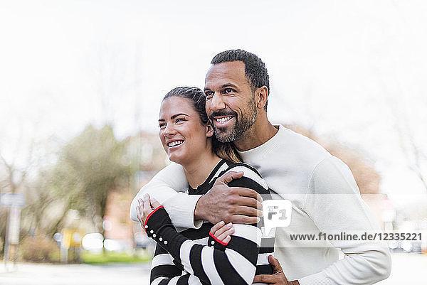 Happy couple having fun outdoors