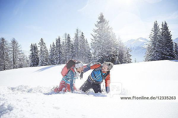 Austria  Tyrol  couple having fun in the snow