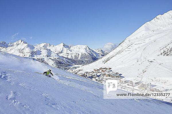 Austria  Tyrol  Kuehtai  man skiing in winter landscape