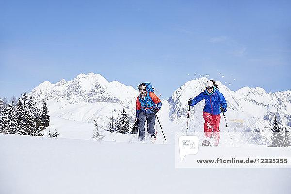 Austria  Tyrol  snowshoe hikers running through snow