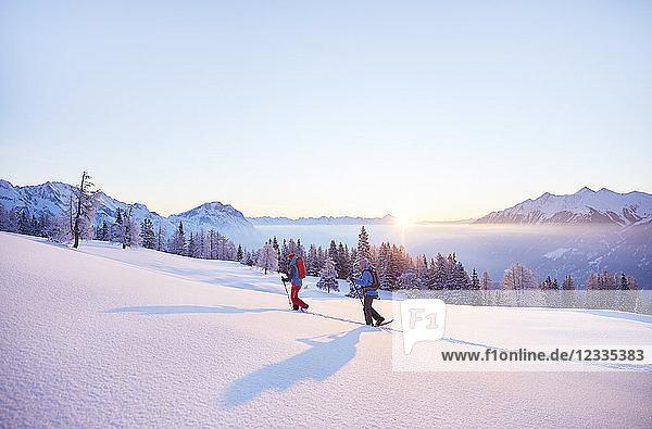 Austria  Tyrol  snowshoe hikers at sunrise