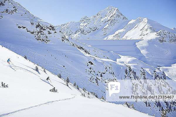 Austria  Tyrol  Kuehtai  couple skiing in winter landscape