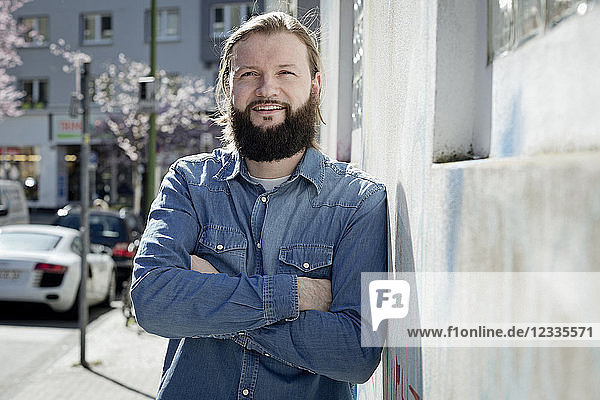 Portrait of bearded man wearing denim shirt