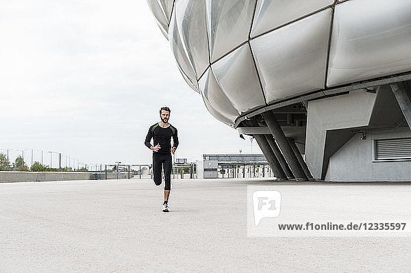 Man running at stadium