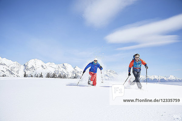 Austria  Tyrol  snowshoe hikers running through snow