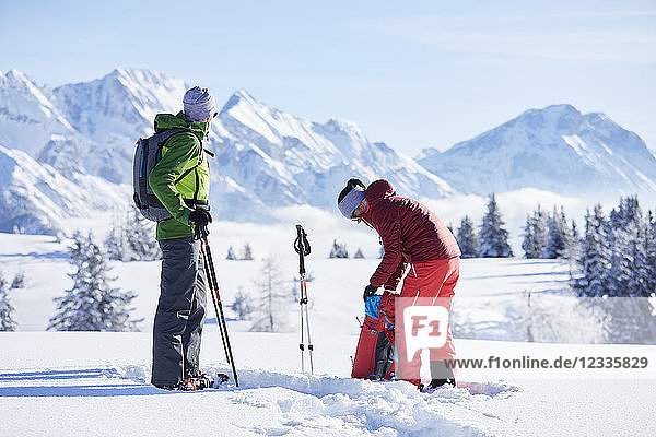Austria  Tyrol  snowshoe hikers
