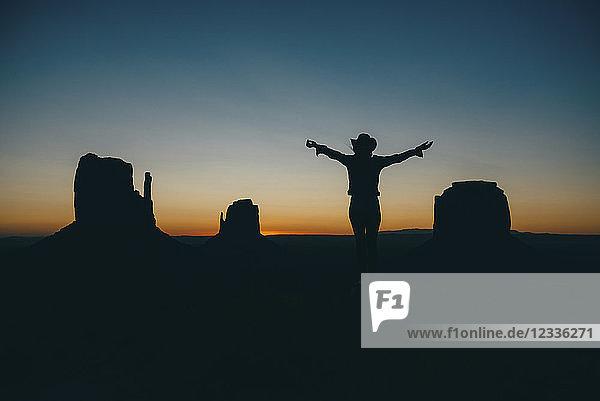USA  Utah  Woman enjoying sunrise in Monument Valley