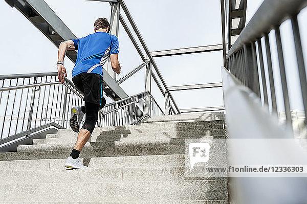 Man running up stairs