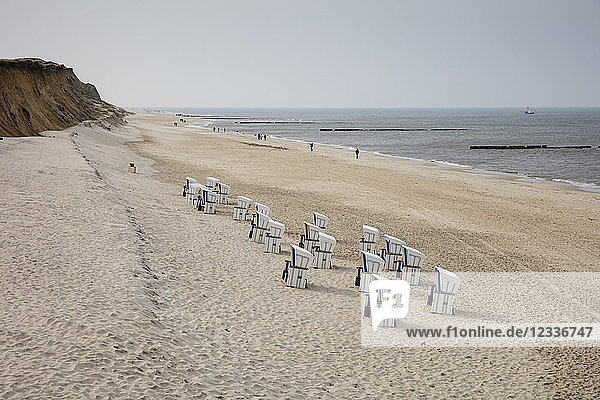 Germany  Schleswig-Holstein  Sylt  beach and empty hooded beach chairs