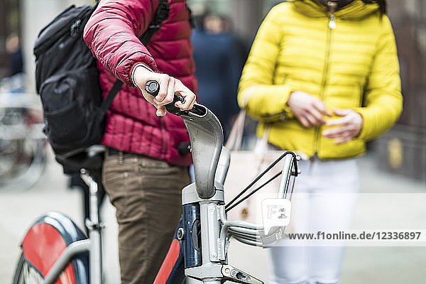 UK  London  man with rental bicycle  partial view