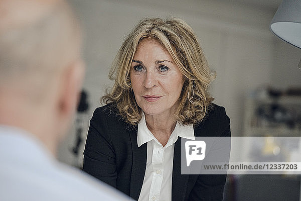 Senior businesswoman looking at colleague
