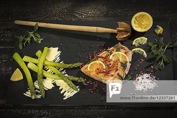 Salmon and green asparagus on slate