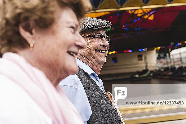 Happy senior couple on fair