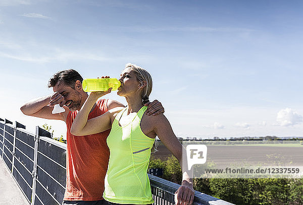 Fit couple jogging in the city  having fun  taking a break