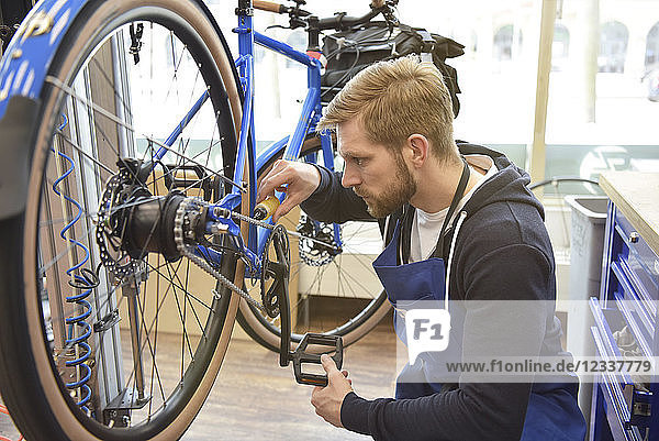 Bicycle mechanic in his repair shop  portrait