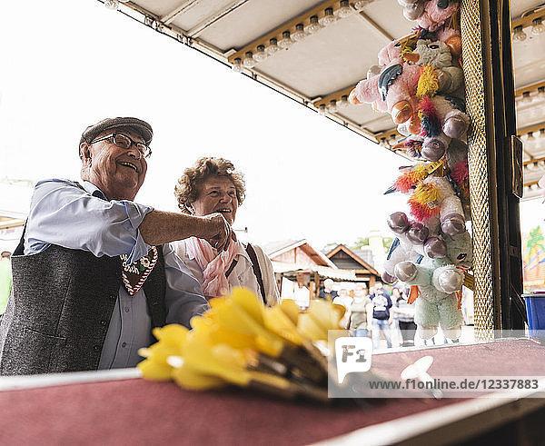Senior couple having fun on fair